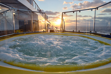 jacuzzi on a cruise ship at sunset