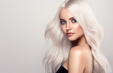 Beautiful girls with hair coloring in blond. Straight and smooth hair coloring in ultra blond color in a beauty salon. Beauty, cosmetics and makeup