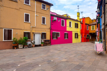 Facades of traditional old houses on the island Burano.