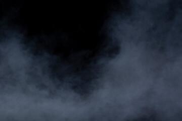 Grey smoke on a black background, fog on a dark background