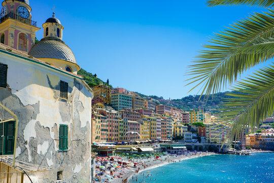 view of Old Town and stone beach on mediterranean coast in Camogli, italian Riviera, Italy