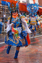 Diablada dancers in ornate costumes parade through the mining city of Oruro on the Altiplano of Bolivia during the annual carnival.