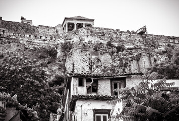 Fototapete - Acropolis of Athens and old houses in Plaka district, Greece. Vintage view of ancient street in Athens city center in black and white.