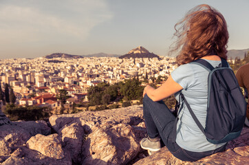 Fototapete - Young pretty woman on background of urban landscape of Athens, Greece
