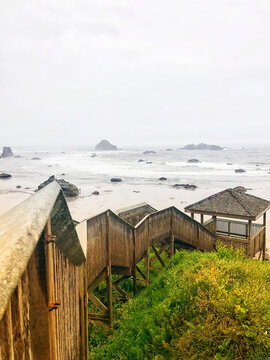 Foggy day wooden beach staircase on the pacific ocean coast in Bandon Oregon