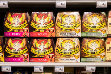 Le Puy-en-Velay, France. Grimbergen Belgian beer at a shelf on a supermarket, originally made by Norbertine monks in the Belgian town of Grimbergen