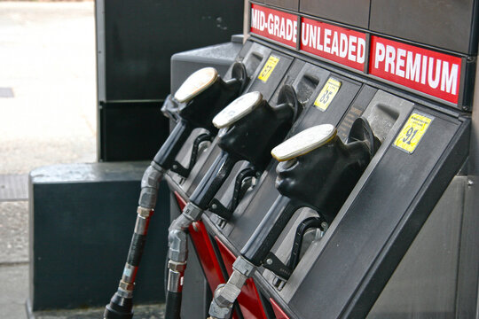 Gas Pumps for Regular, Unleaded and Premium Gasoline at a Service Station