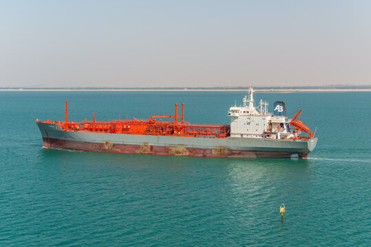 Suez, Egypt - November 14, 2019: LPG Tanker vessel Ramagas passing Suez Canal in Egypt. An LPG tanker is a gas gas tanker ship designed for transporting liquefied petroleum gas (LPG) in bulk.