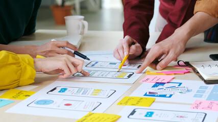 Brainstorm planing creative teamwork,  Close up of hands mobile phone app developer team meeting...