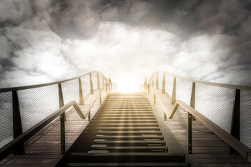 The stairs to heaven. Up the stairs. Condolence card. Empty place for emotional, sentimental text or quote. Black and white image with golden sunbeams