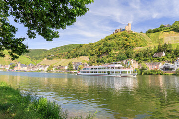 Ship on the Mosel river at Bernkastel-Kues with ruin Landshut