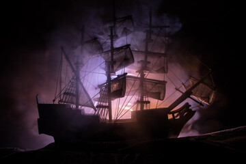 Black silhouette of the pirate ship in night