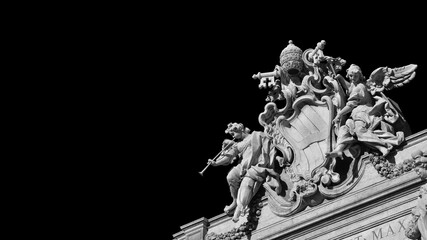 Baroque Art in Rome. Emblem of Pope Clement XII between angels with trumpets, at the top of the beautiful Trevi Fountain, 18th century (Black and White with copy space)