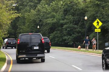 U.S. President Donald Trump's motorcade heads into his Trump National golf course, in Washington