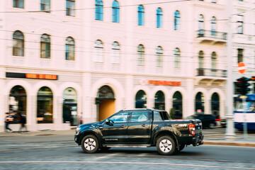 Black Ford Ranger Wildtrak Fast Drive In Summer City Street. The Third-generation Ford Ranger