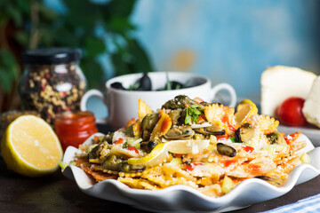 Seafood pasta with mussels and parmesan cheese on a plate