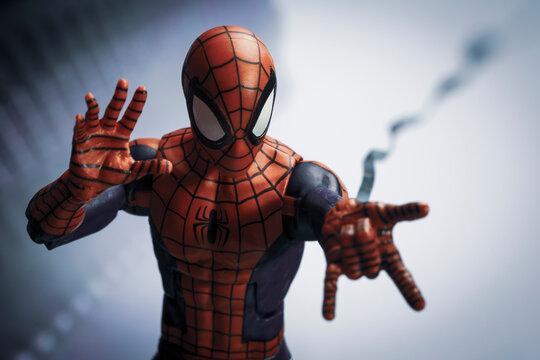 NEW YORK USA - AUGUST 2 2020: Scene with Marvel comic superhero Spiderman shooting a web - Hasbro Marvel Legends figure