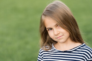 Salon care for you and your hair. Little kid wear long hairstyle outdoors. Hair salon. Beauty...