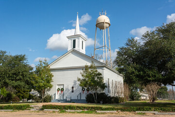 Chappell Hill, Texas, United States of America - December 27, 2016.  Providence Baptist Church building dating from 1873, and water tower in Chappell Hill, Texas.