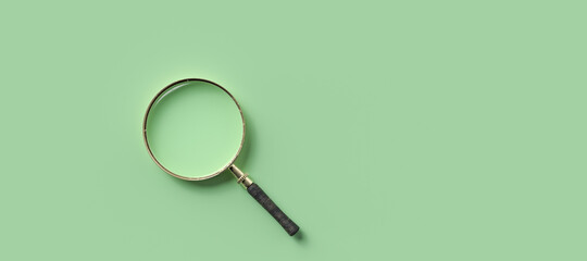 magnification glass on the left on empty green background