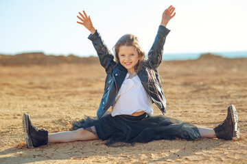 Children's fashion. Fashionable child. Girl outdoors in fashionable clothes. High quality photo.