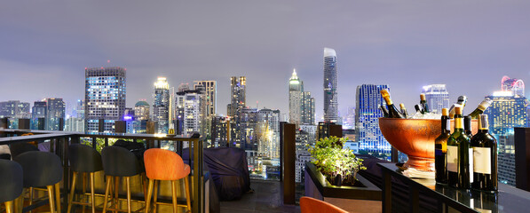 Bangkok city view point from rooftop bar, overlooking a magnificent cityscape blue sky and city light, Thailand