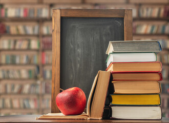 Back to school. Book, apple and chalk board