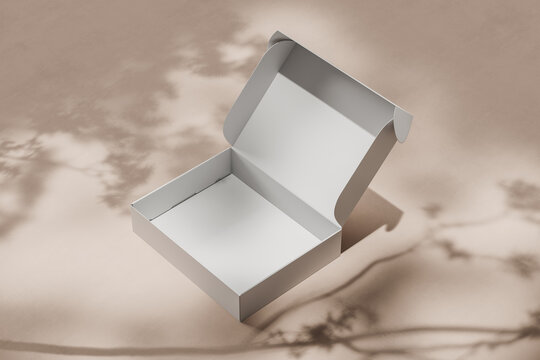 White open empty cardboard box for packing a gift or order on a light beige background with shadows. Side view. Mock up. 3d rendering