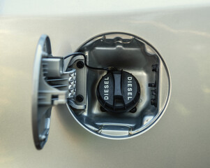 Diesel fuel cap of a grey car