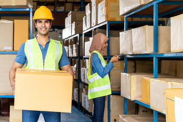 Indian warehouse worker hold cardboard box