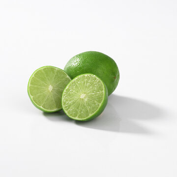 Closeup of small green key limes isolated on a white background
