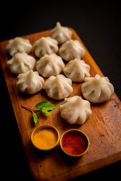 Modak is an Indian sweet popular in states of Maharashtra, Goa. The sweet filling on the inside consists of freshly grated coconut and jaggery while the outer shell is made from rice flour or semolina