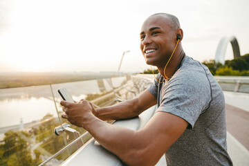African american athlete man listening to the music