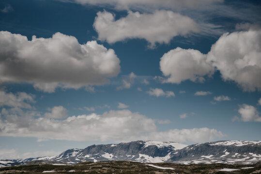 Clouds in the mountains. Hallingskarvet National park in Norway.