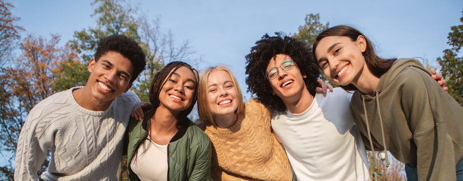Portrait of overjoyed teenagers having fun outdoors