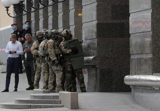 Members of a Ukrainian special forces unit are seen outside a building where an unidentified man reportedly threatens to blow up a bomb in a bank branch, in Kyiv