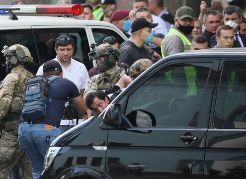 Members of a Ukrainian special forces unit detain a man who threatened to blow up a bomb in a bank branch, in Kyiv