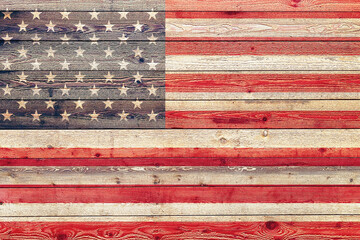 faded american flag painted on wood siding graphic with stylized stripes and stars