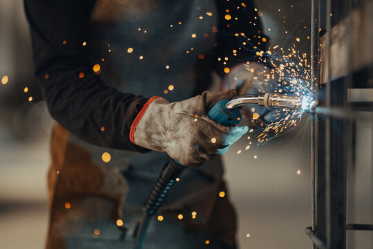 Experienced welder works in the factory