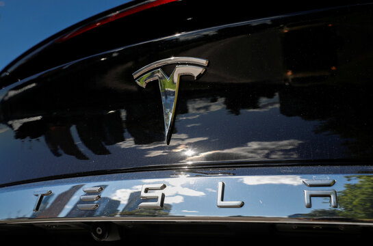 The company logo is pictured on aTeslaModel X electric vehicle in Moscow