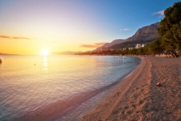 Makarska pebble beach and Biokovo mountain sunset view