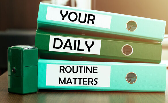 3 green office folders with text Your Daily Routine Matters