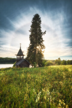 Solar Halo and Chapel of Cosmas and Damian in the village of Uzkiye on the shore of Cosmoser. Zaonezhye