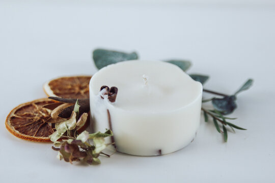 Eco soy wax candles with dried flowers and fruit. Aromatherapy, scented decorative candle.