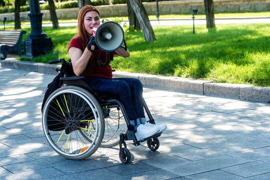 Disabled girl with a megaphone in her hand