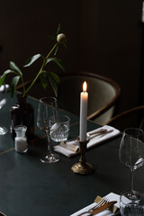 Served table at night with lighted candle