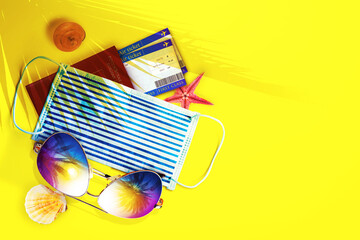Sunglasses with Coronavirus mask on the beach