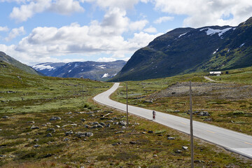 Cyclist on the road 52, near to Hemsedal, Norway