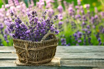 Fresh lavender on wooden table. Summer flower background.