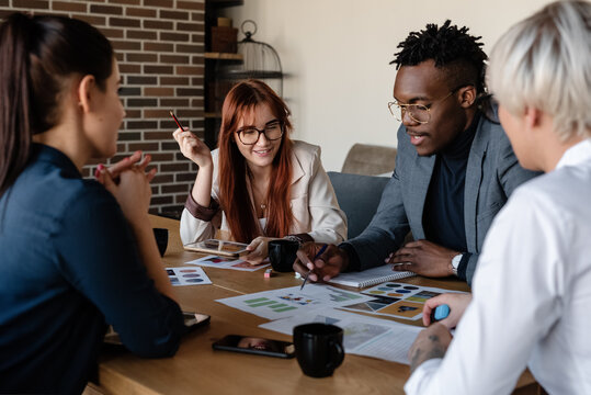 Professional multiethnic coworkers discussing project in conference room